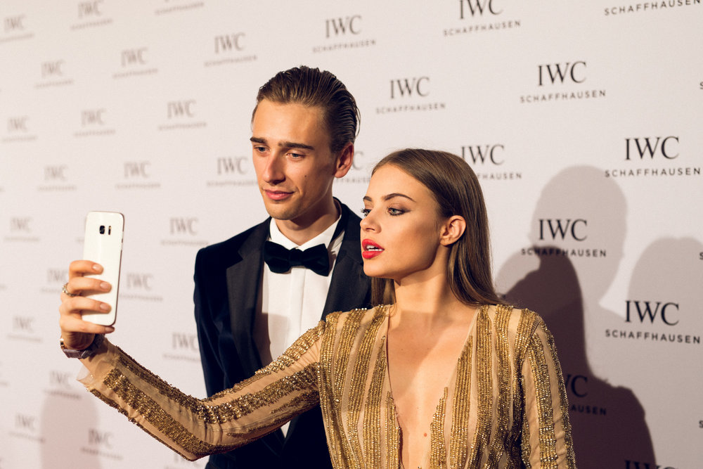 Oliver and Xenia Tchoumi filming for IWC's Instagram Stories