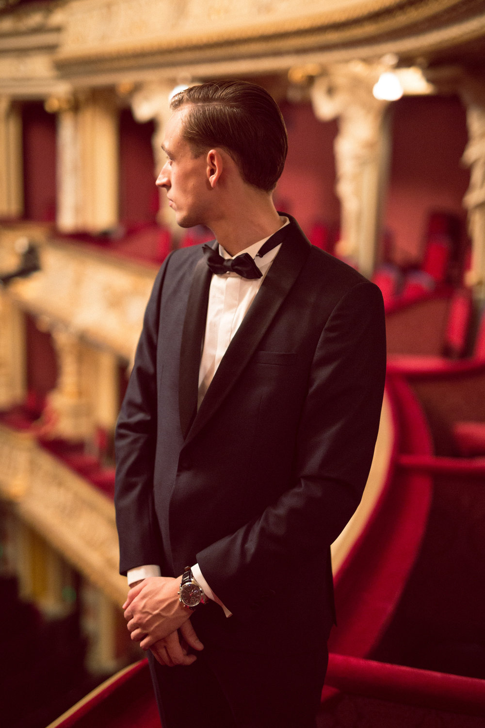 Moritz inside the Opera House, dressed in Z Zegna and wearing an IWC Portugieser Chronograph Classic watch