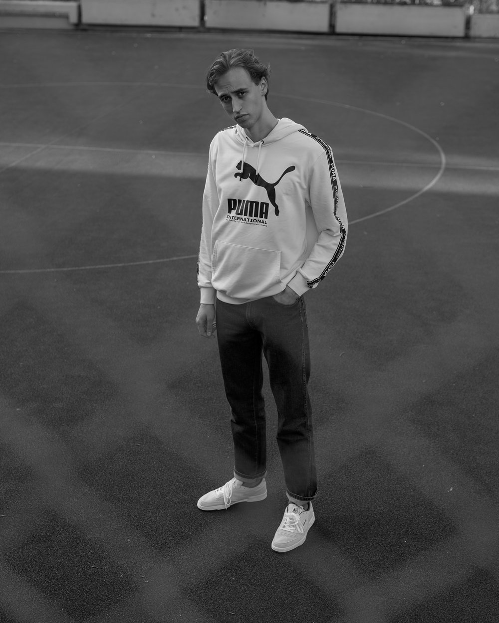 Moritz is wearing a Puma sweatshirt, Wrangler jeans and a pair of Reebok Classic 'Club C 85' sneakers.