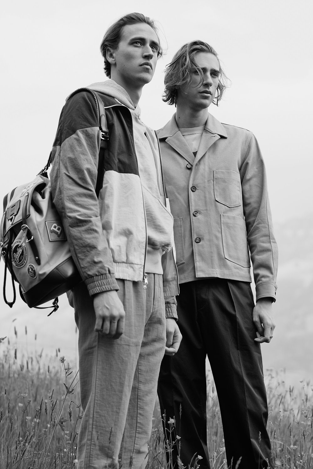 Moritz wears jacket and sweater by Aimé Leon Dore, trousers by Études and backpack by Bally. Oliver wears jacket by Acne Studios, sweater and trousers by Marni.
