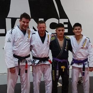 lindsey black belt group pic.jpg
