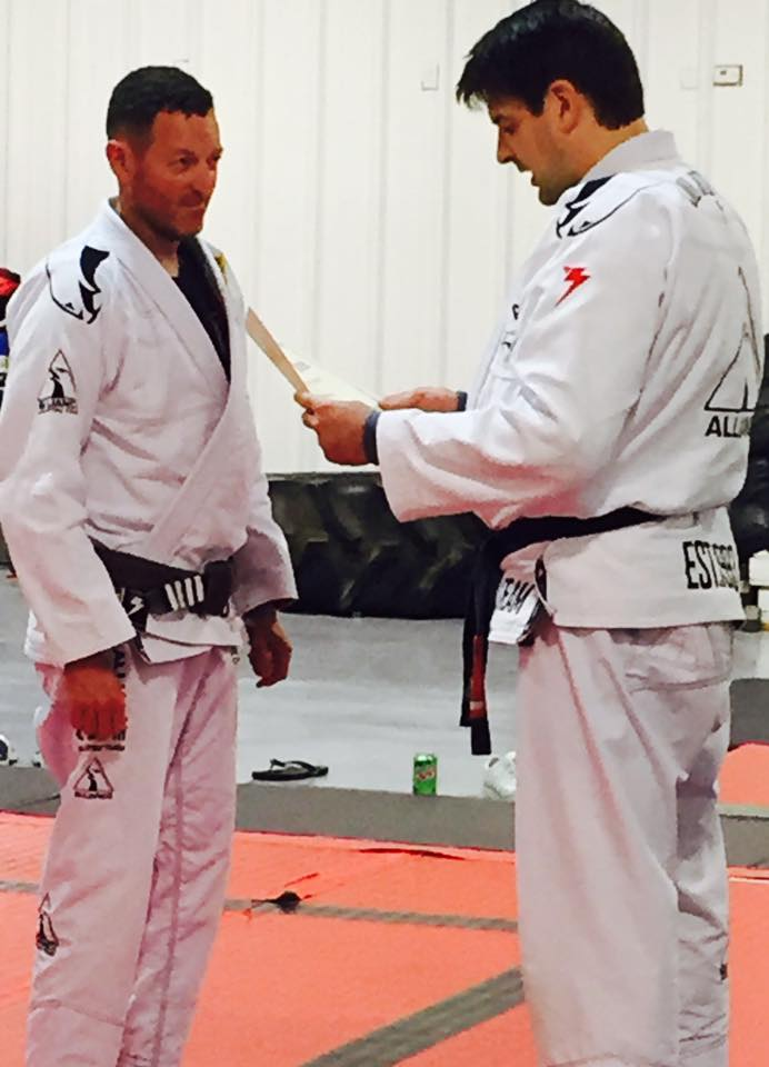 Lindsey getting black belt.jpg