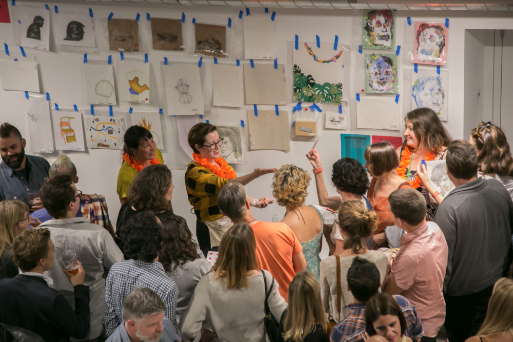 Liz auctioning off coveted pieces at Southern Exposure's Monster Drawing Rally at Minnesota Street Project | San Francisco, CA | 2016