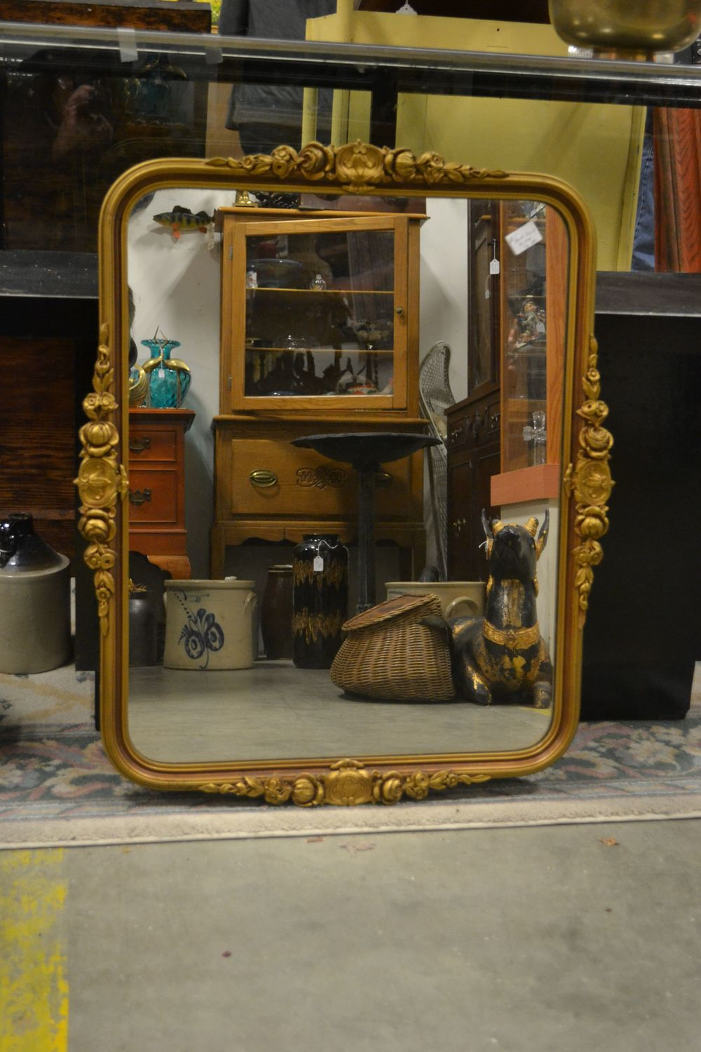 beautifully shaped mirror that would fit anywhere - as long as it reflects something nice!