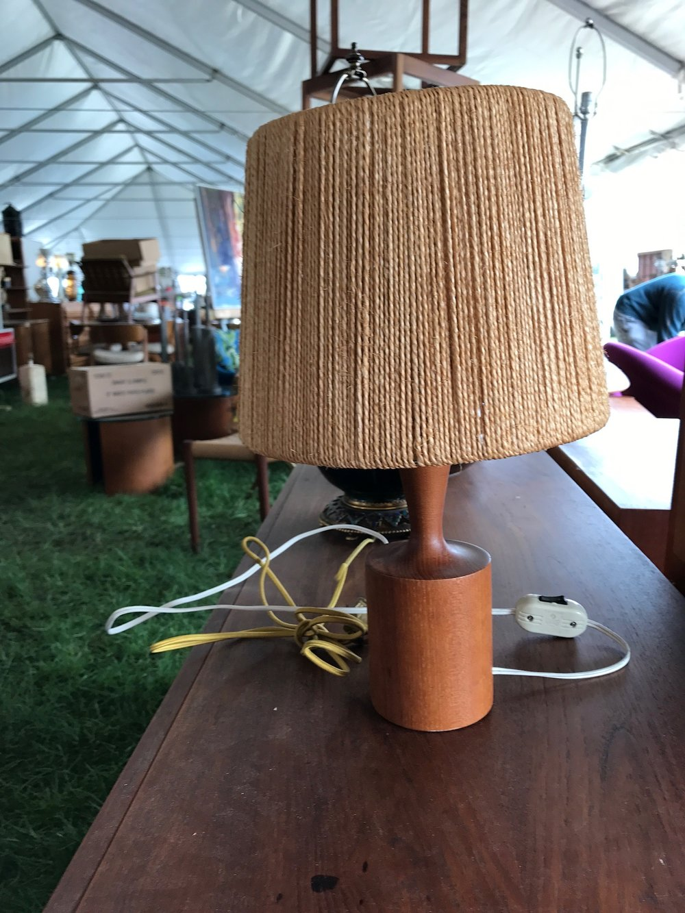 We love this petite Danish modern lamp. Maybe all it needs is a fresh white burlap shade. Maybe.