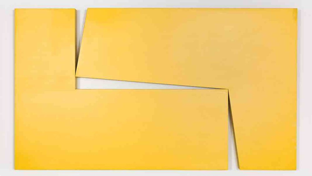 "Image:  Carmen Herrera,   Amarillo ""Dos""  , 1971.   Acrylic on wood   40 x 70 x 3 1/4 in.   Maria Graciela and Luis Alfonso Oberto Collection © Carmen Herrera"