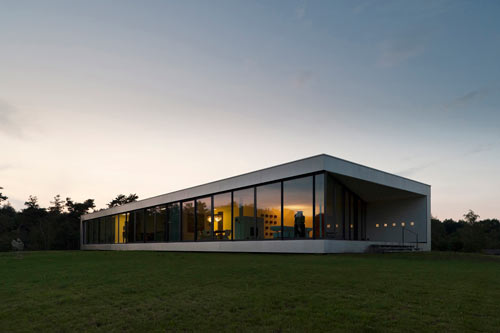 Glass curtainwall Bridge house by 123DV in the beautiful Dutch landscape