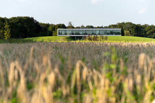 Glass curtainwall Bridge house by 123DV in the beautiful landscape of the Dutch Achterhoek.