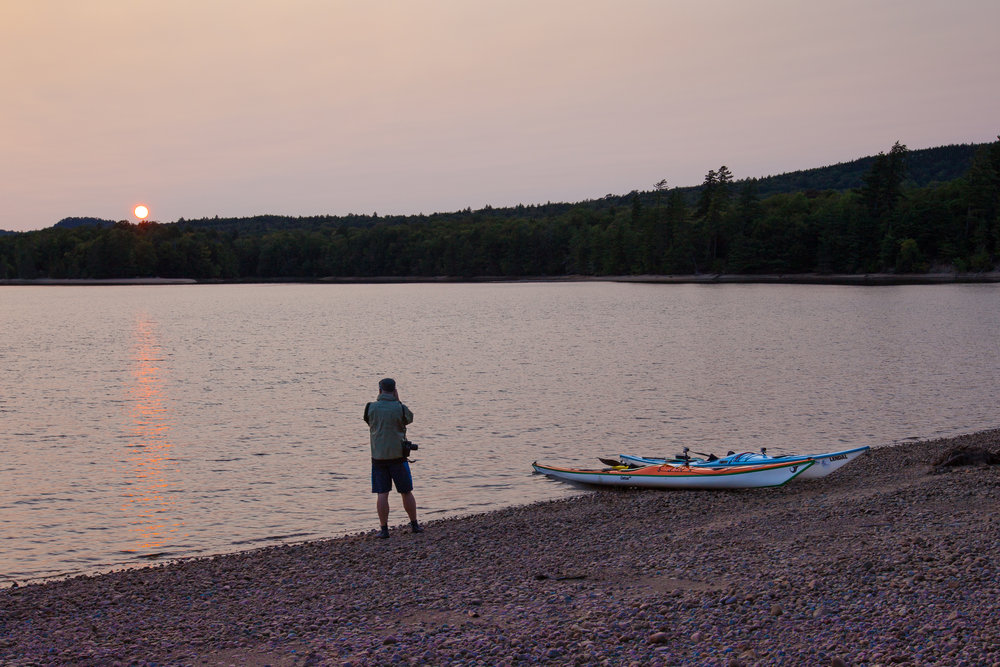 Jeff capturing the sunset during an evening paddle session.