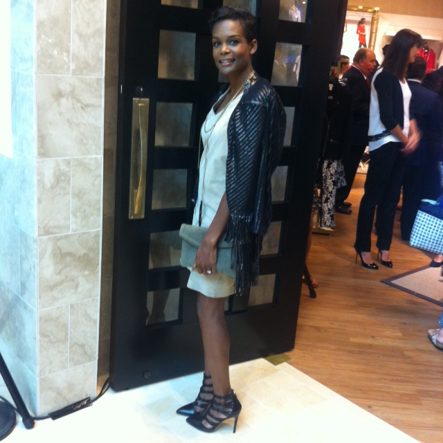 Sporting Chico's Faux-Leather Artisan Duster at the opening event at Square One Shopping Centre.