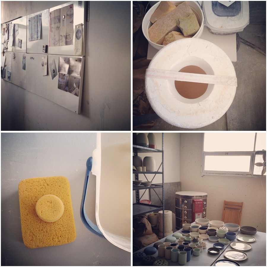 Tools of the trade: a pin-up board, plaster molds, a kiln, sponges, and buckets.