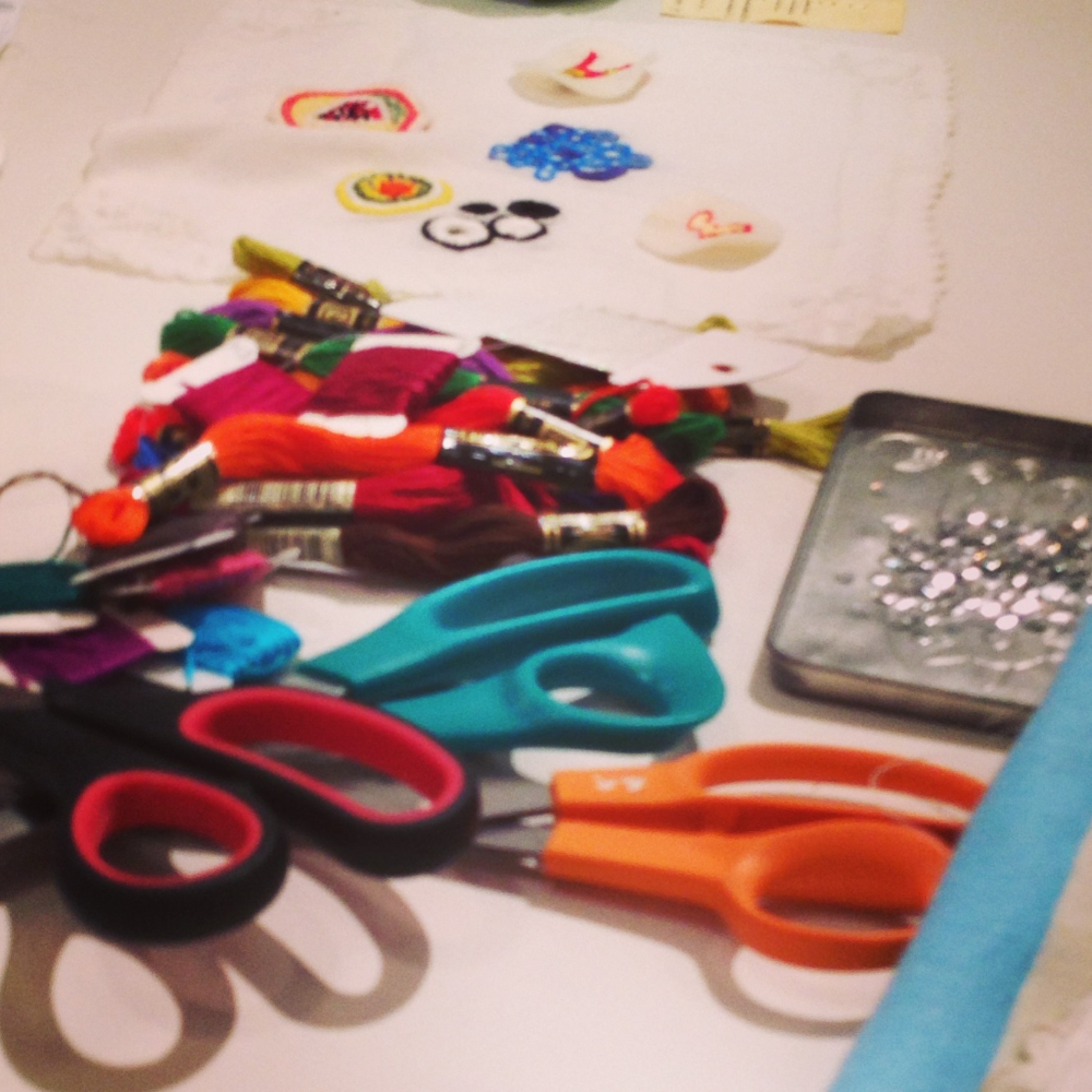 Supplies: scissors, stitch samples and sequins!