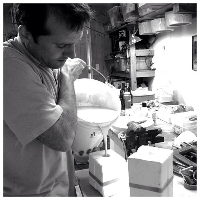 Heath pours slip into a plaster mold.