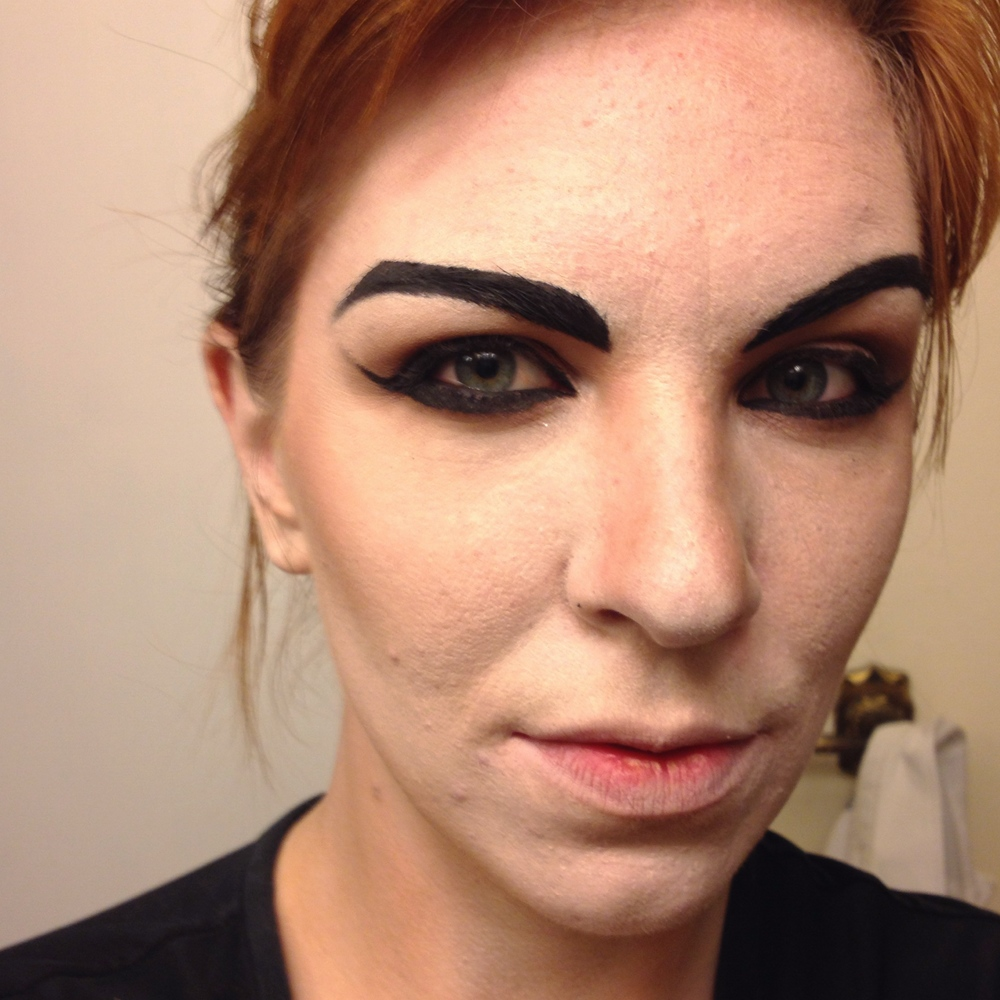 Use a black gel liner and an angled brush to shape and define brows, as well as create a cateye.
