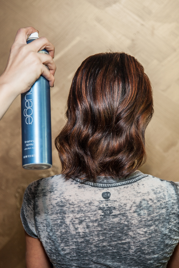 After you have brushed through the hair, take a firm but flexible hairspray and spray root to ends, 8-10 inches away to calm down any fly-aways, give shine and strength to the hair.  I used  Aquage Finishing Spray .