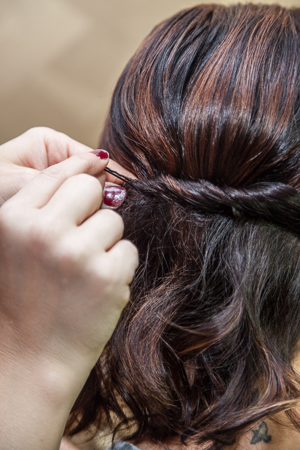 Flip the bobby pin up and press it in and down at an angle.