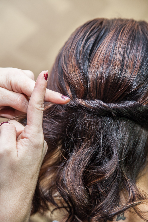 Underneath all the hair, this is what the bobby pins should look like.  When doing it like this, you hide the bobby pins and the section stays secure.