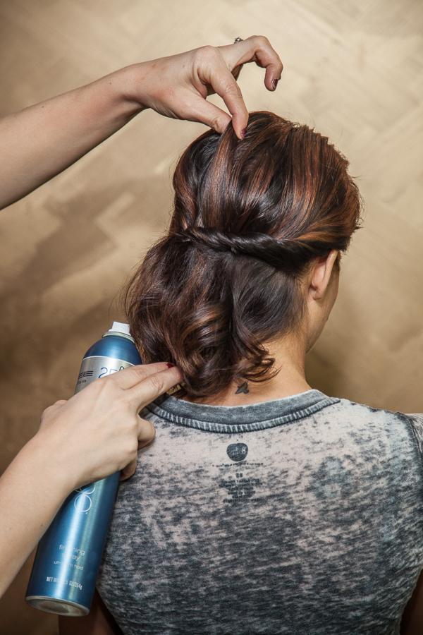 Very carefully, pull up on the top of the hair to create volume and movement.  I constantly spray the Finishing Spray while I'm working to make sure the hair is not too soft and keeps the shine.