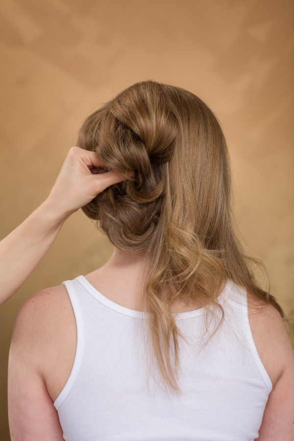 Wrap the ends around your finger and pin into base of head using two bobby pins to create an X to lock the section in.