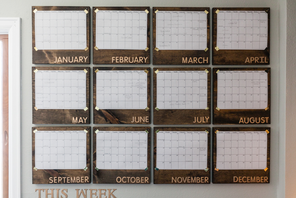 I live by calendars.  Everything is done in Google calendar but I have to have a paper calendar on my wall to see my year as a whole so I don't over schedule myself like I have in the past.  I finally found a way to make my paper calendar look aesthetically pleasing to my eye.  Stained pine wood from Home Depot, papers attached with gold washi tape, raised letters from Hobby Lobby, sprayed with gold spray paint.