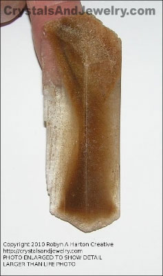 "Hourglass Selenite Example - Sand inclusions give it the internal ""hourglass."""