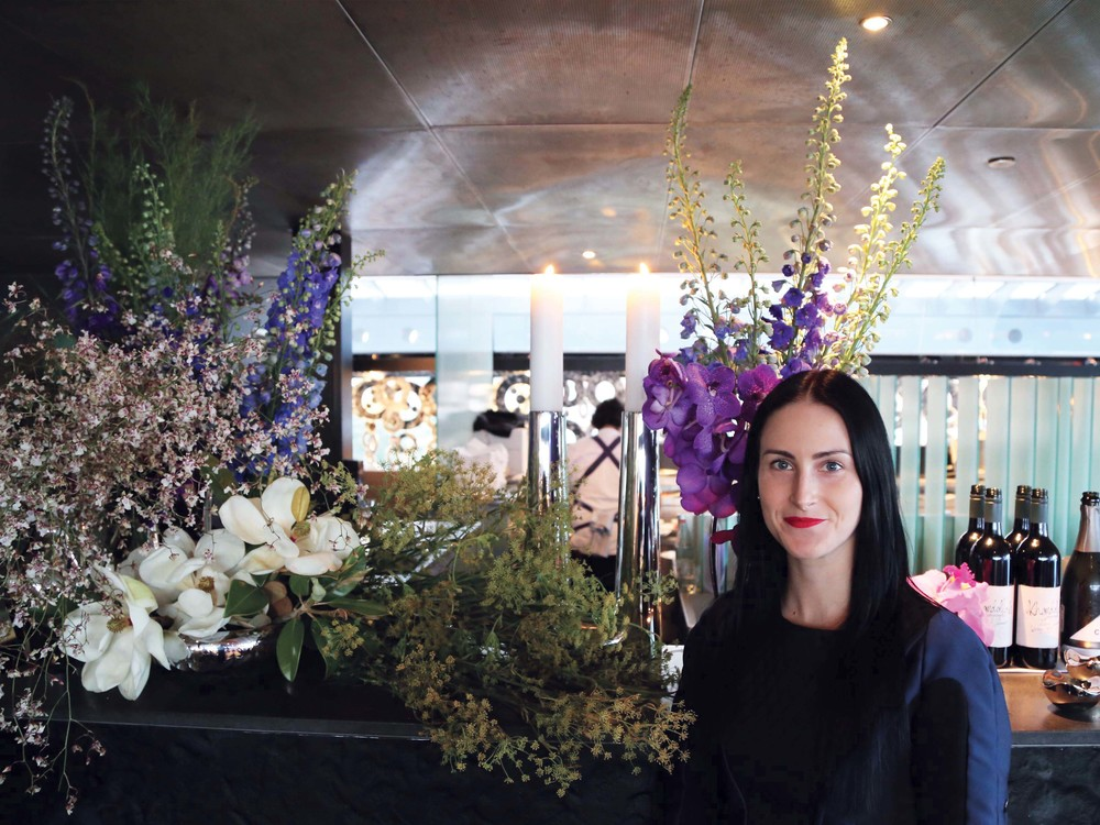 Kiri Yanchenko in front of the Gradiflora Flowers, photo by Wesley Taylor