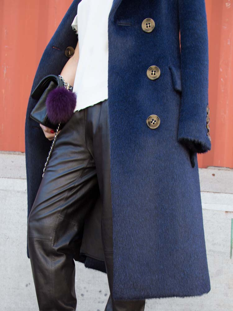 DETAILS:Burberry Classic Blue Coat, Fur Bag Charm, Chanel Bag,VINCE Leather Track Pants