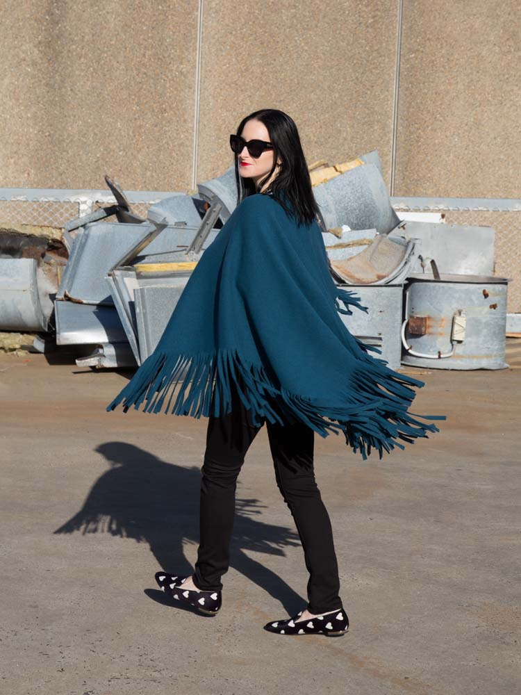 Burberry Poncho, White T-Shirt, Burberry Black Jeans, Karen Walker Sunglasses, Burberry Loafers