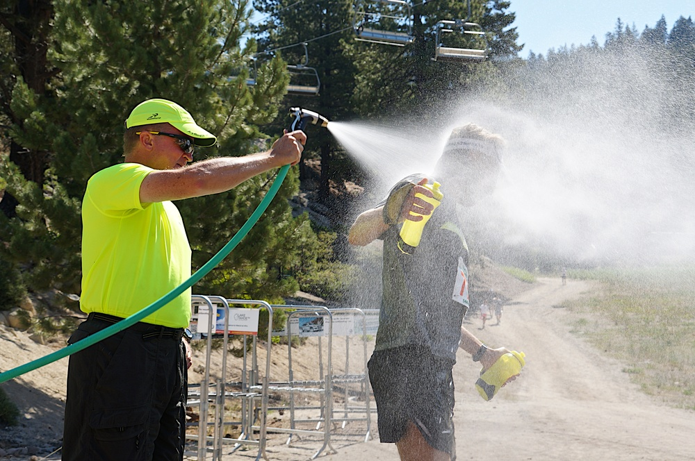 With temps feeling like 100º + , runners were greeted with a hose down if they liked as they left Diamond Peak Aid Station, mile 30.3