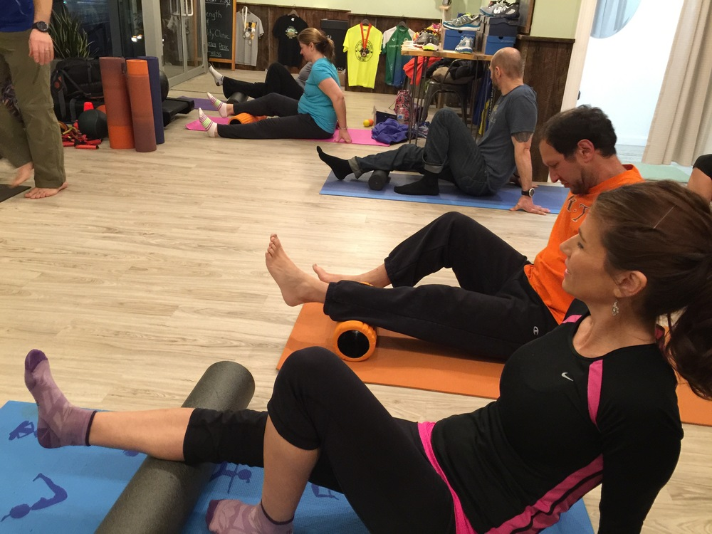 Foam rolling my calves at the mobility & strength clinic.