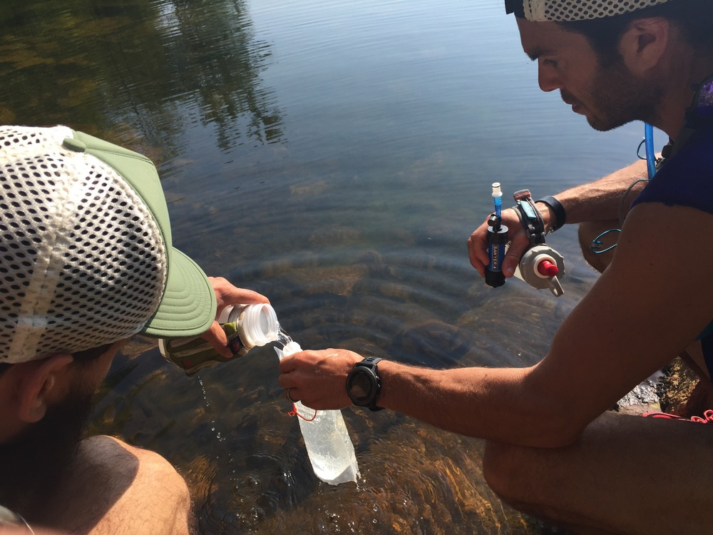 Jay Lemos and Julian Vicente filtering water at the Third Reservoir that is right on the trail.