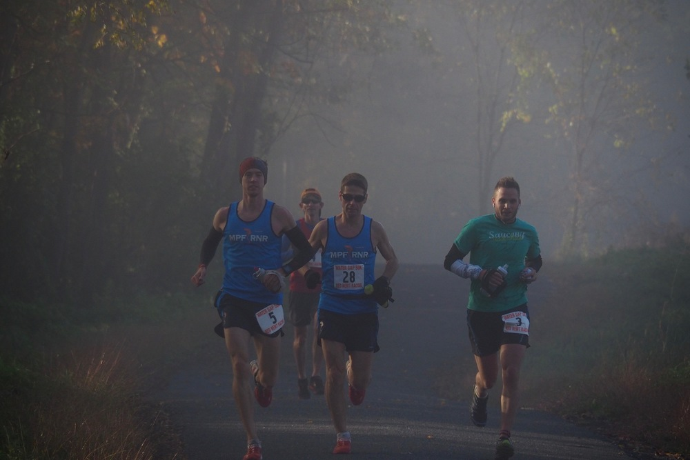 Running through the early morning mist early in the race