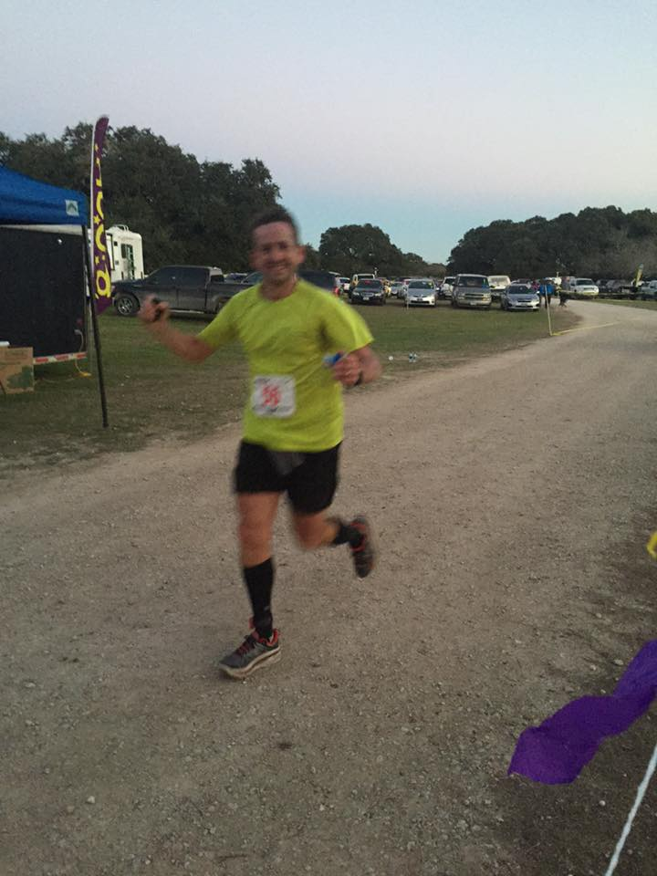 A very happy, blurry Phil, who had a great race to finish in 10:38. This is the only picture I took all weekend.