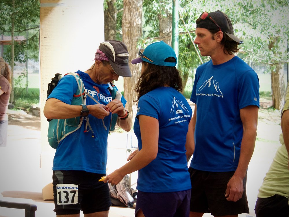 Elizabeth coaching Harry Hamilton to his first finish of the Hardrock 100!