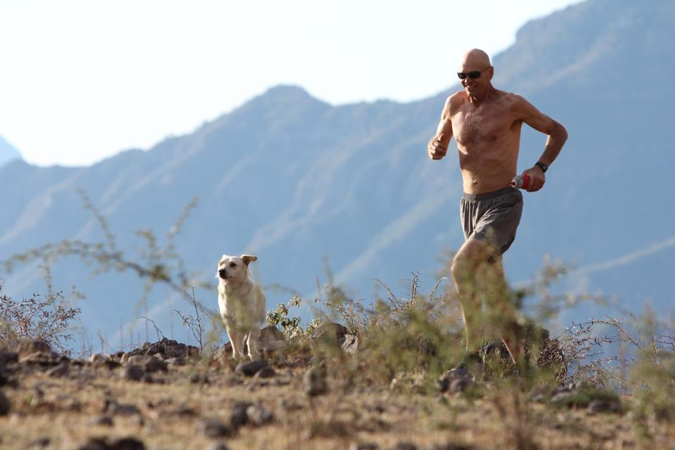 "Micah True, el Caballo Blanco, running in the Canyons with his dog Guadajuko - Photo by Leslie Gaines 1953 ---2012 ""Corre Libre Caballo Blanco!"""