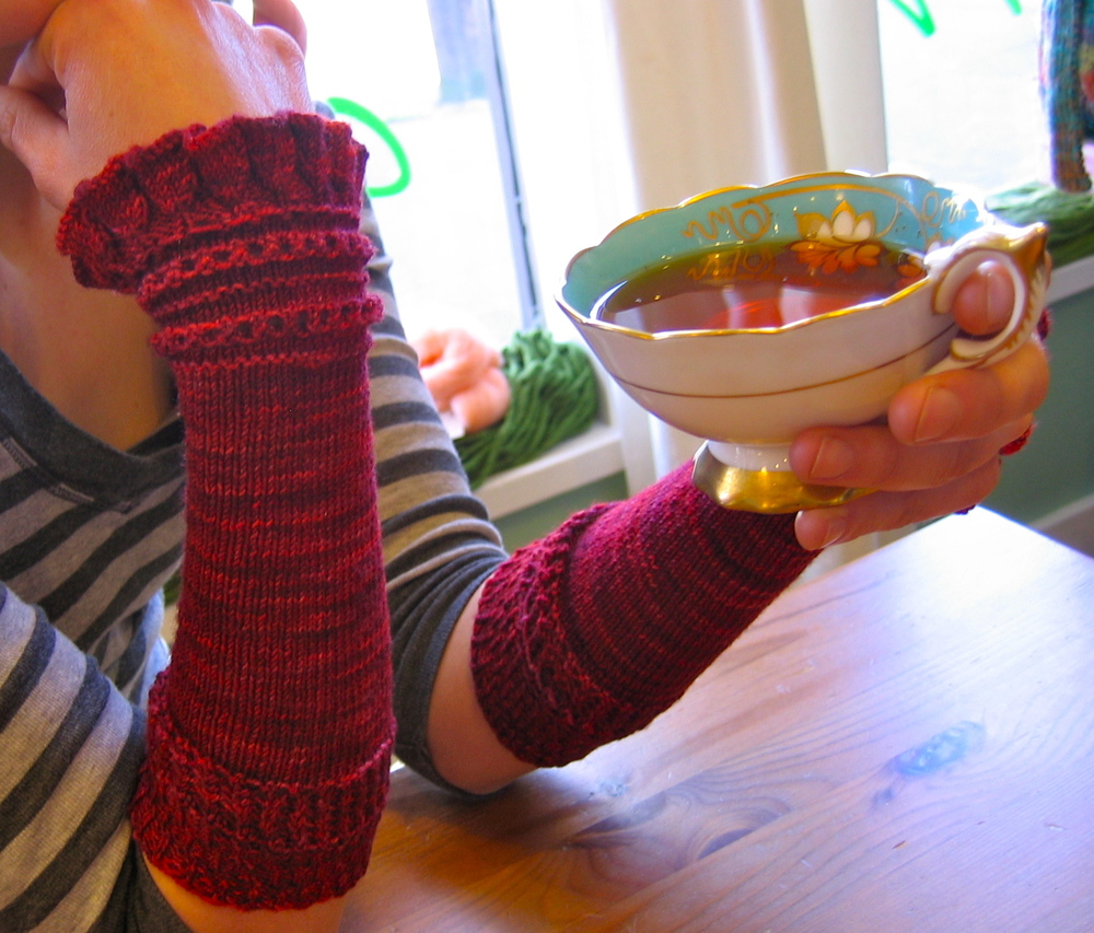 "Red Velvet Cupcakes are sleeves inspired by something Holly Golightly might wear in Breakfast at Tiffany's. They were created to bring some feminine elegance to any occasion.  Holly Golightly: ""It's useful being top banana in the shock department.""   Pattern available on  Ravelry"