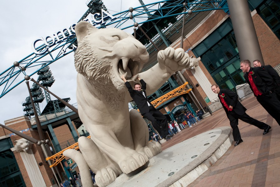 Ryan hanging by the fangs of the Tiger at Comerica Park in Detoit, Wally Spice Photography