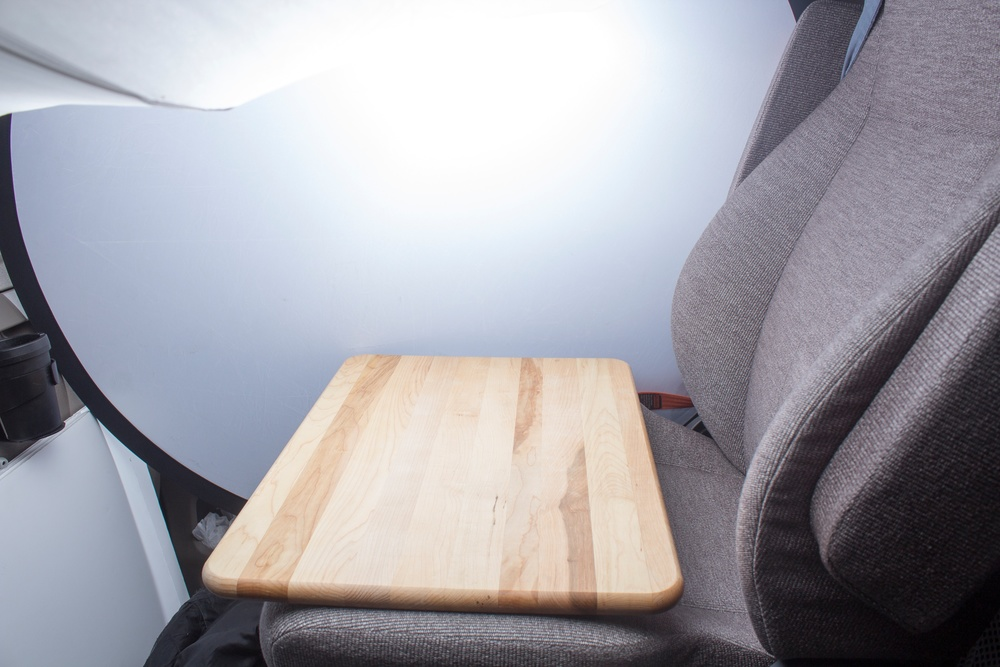 Here I set a cutting board on the seat to use as my working surface. You can see that the light is significantly better than when I started.