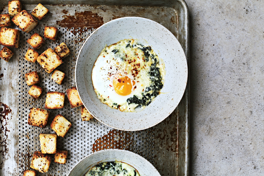 Sara Forte's Baked Eggs with Barely Creamed Greens and Mustardy Bread | Photo by Tara O'Brady