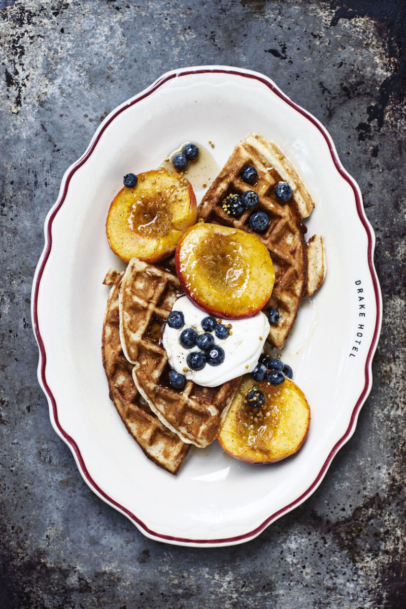 Heidi Swanson's Whole Wheat Waffles with roasted peaches and mapled blueberries | by Tara O'Brady