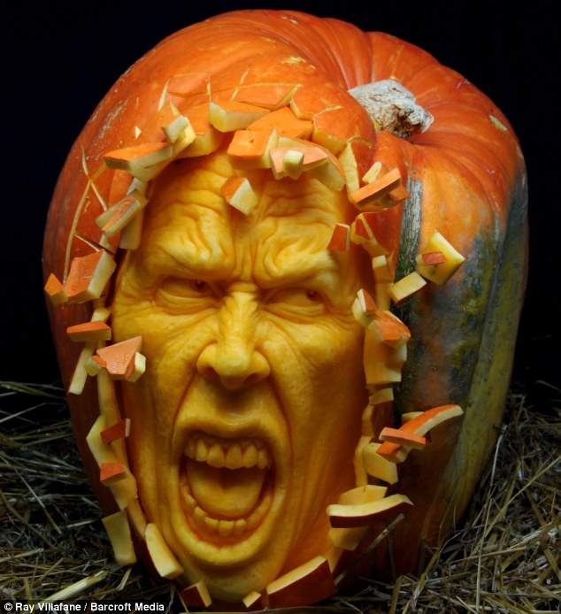 Horrifyingly good: Ray Villafane takes, on average, just two hours to carve one of his pumpkin sculptures, like this one entitled Shattered .jpeg