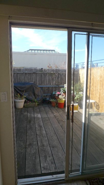lest you be fooled, that fencing only went 1/3 of the way around the deck.  juuuuust enough for the realtor's photo.