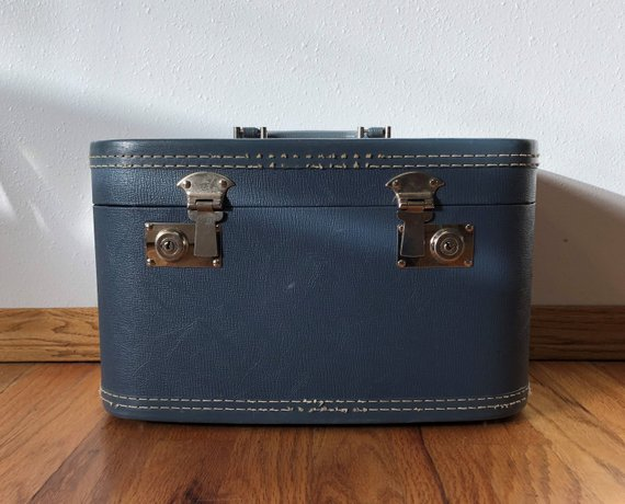 Vintage blue train case , Etsy, $25
