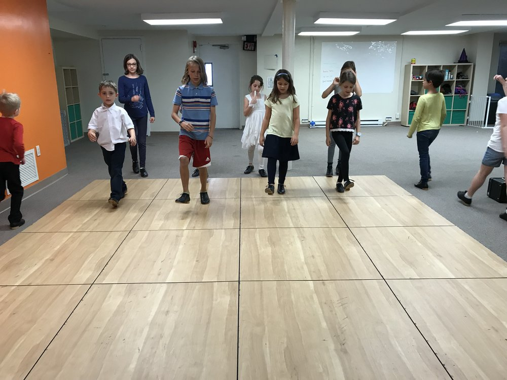 "We have been including ""across the floor"" time as part of our warmup, working on executing our steps in time with each other.   We do ""dee dum"" patterns, including the Connemara basic (forward and back), and the ""Snoopy Shuffle"""