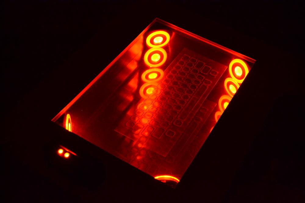 "Omniscience (Desktop Detail) , 2013   3' x 27"" x 32""  Steel, Plexi-glass, LED's, Mirror, Micro-chips, 3-D Glasses, Upholstery, Poplar, Paint "