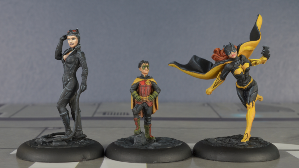 Catwoman, Damian Wayne Robin, and Batgirl from Knight Models' Batman Miniature Game.