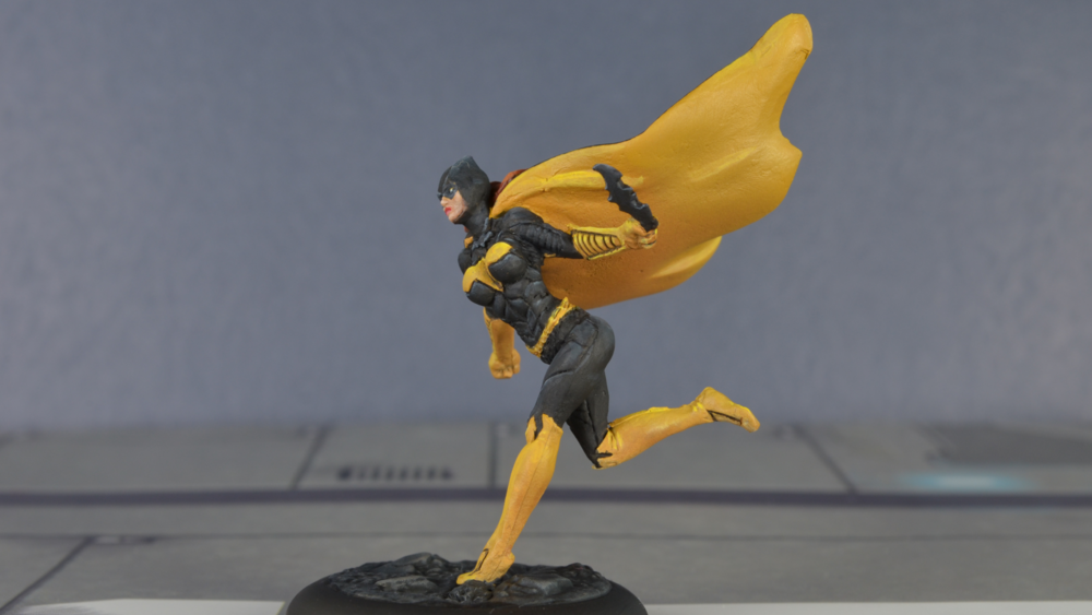 Batgirl from Knight Models' Batman Miniature Game. I love this sculpt, and a happy accident made it even more awesome.