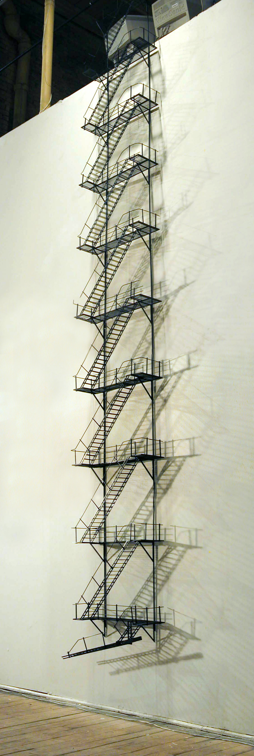05_Tom Lauerman, Fire Escape (Detail), 2004, wood, metal, plastic, paint, 18x4x180, private collection.jpg
