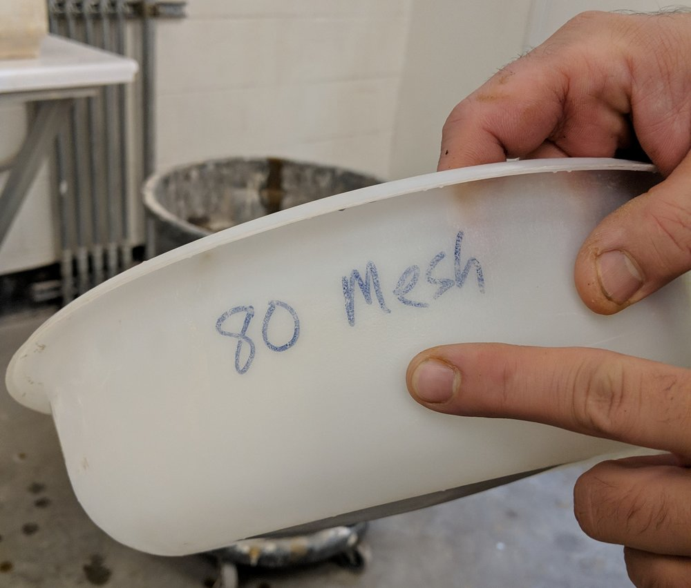 An 80 mesh sieve was used next, slowing the process down quite a lot.