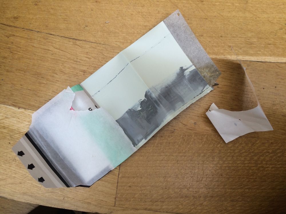 Today, only the negative and part of the tab came out while taking a picture with old expired Polaroid Sepia film. The positive remained inside the camera, together with dry chemicals made powder. Never seen this before.